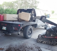 Mini skid steer unloading exposed aggregate planters